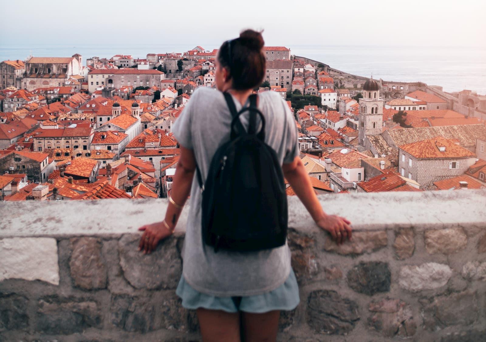 woman looking at buildings 2040627