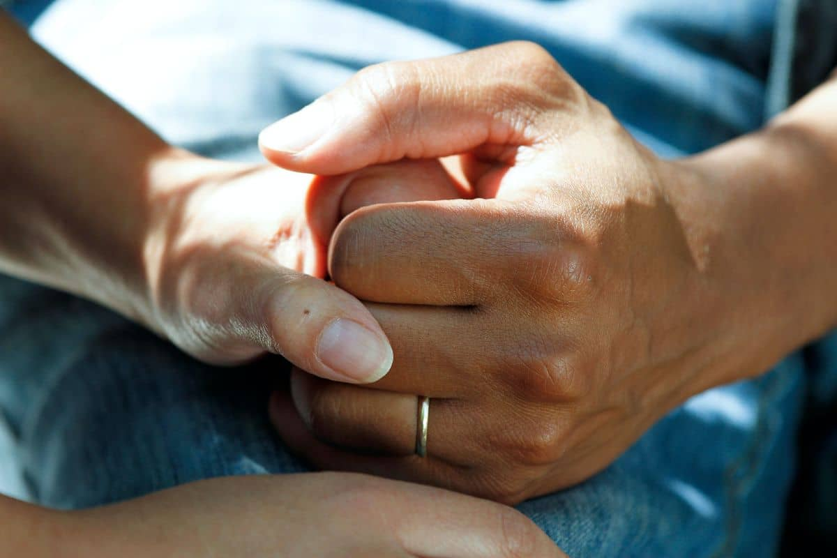epilepsy Life Insurance client holding hands