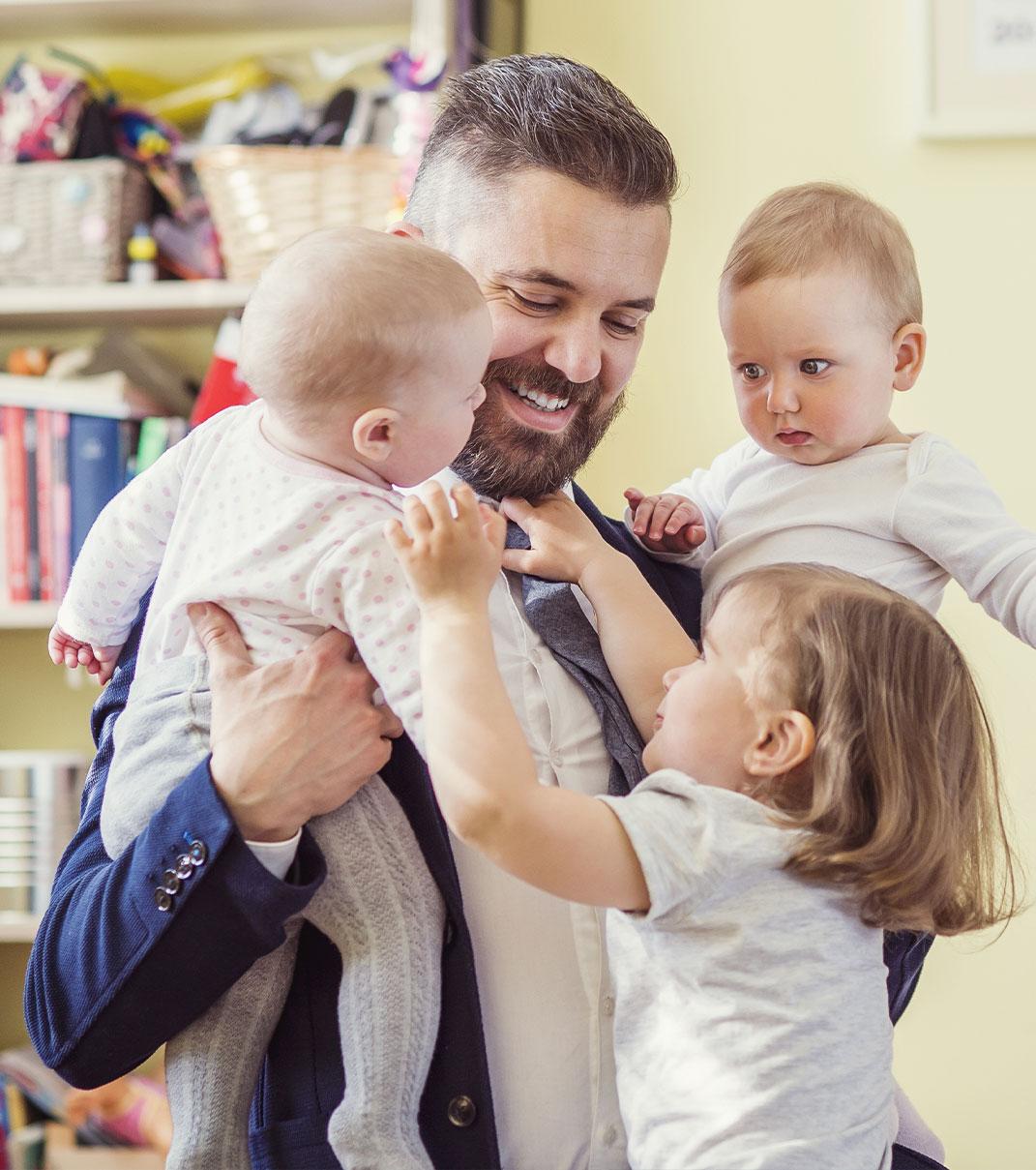 Man with three children